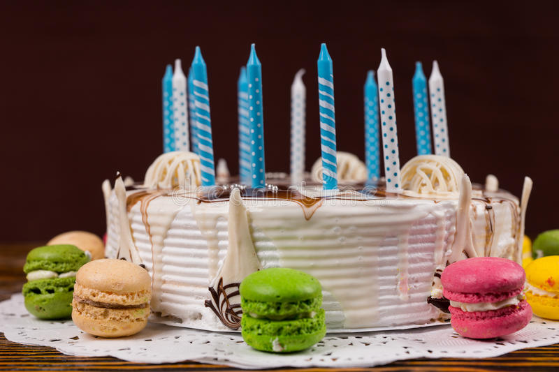 White Birthday Cake With Lots Of Candles Near Different Colored