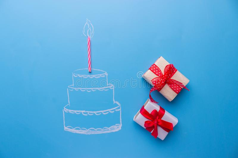 White birthday cake over blue background royalty free stock photos