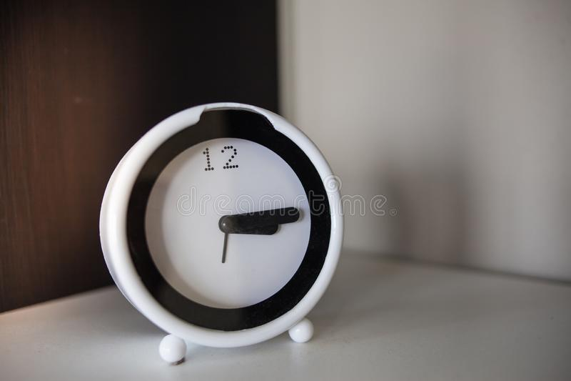 White & Black Alarm Clock. Alarm-clock, alert, analog, antique, awake, background, bell, business, circle, classic, concept, countdown, day, deadline, design royalty free stock photo