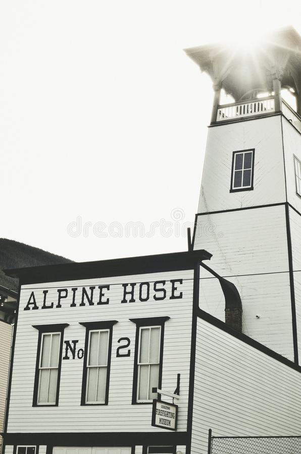 White and Black Alpine Hose Building royalty free stock photography