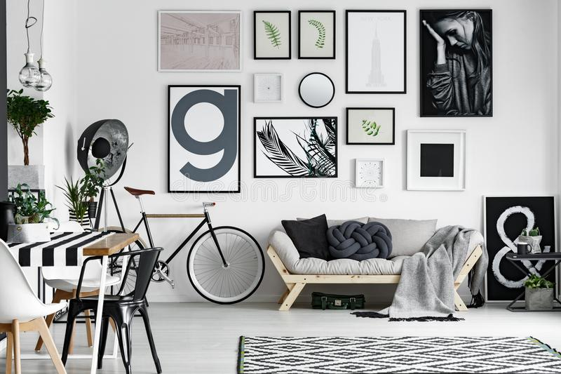 Bike in the room. White and black bike standing in the corner of bright room royalty free stock photography