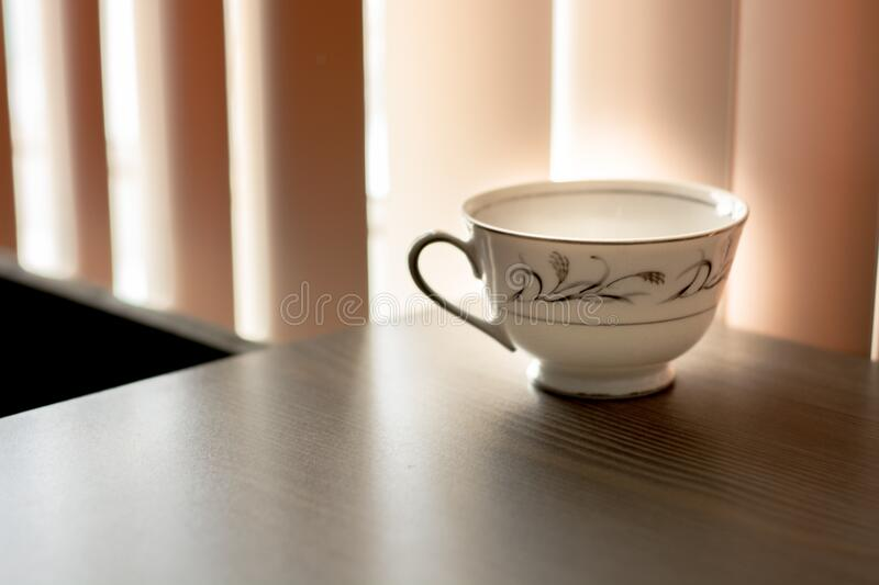 White And Black Ceramic Teacup On Brown Wooden Surface Free Public Domain Cc0 Image