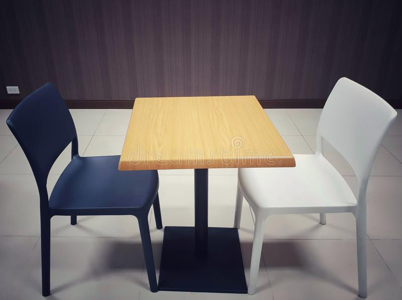 White and black chairs and table. In the empty restaurant stock photos