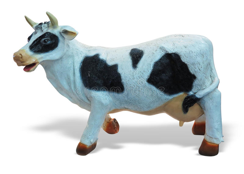 White and black cow toy figurine isolated.  stock images