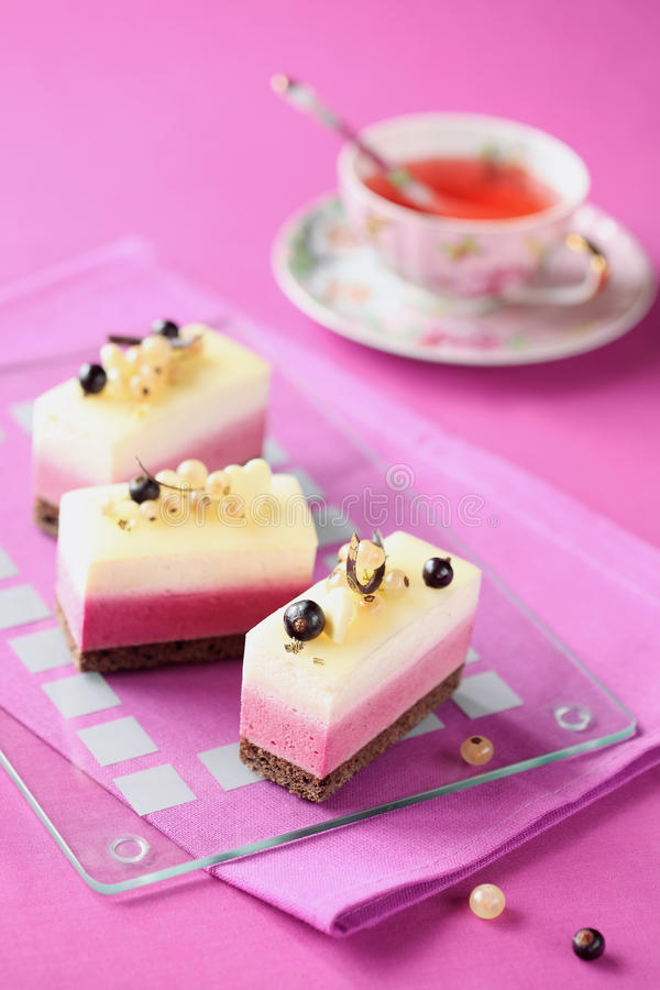 White and Black Currant Mousse Cakes royalty free stock photography
