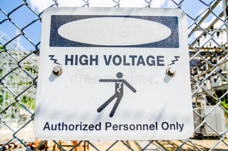 white and black danger warns trespassers away from this substation. royalty free stock photography