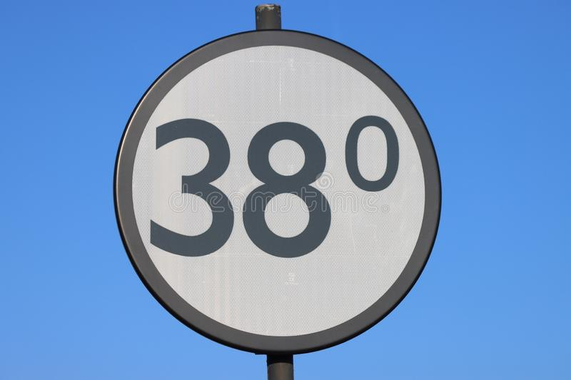 White and black distance sign with 38 kilometer along the rails for trains in the Netherlands stock photos
