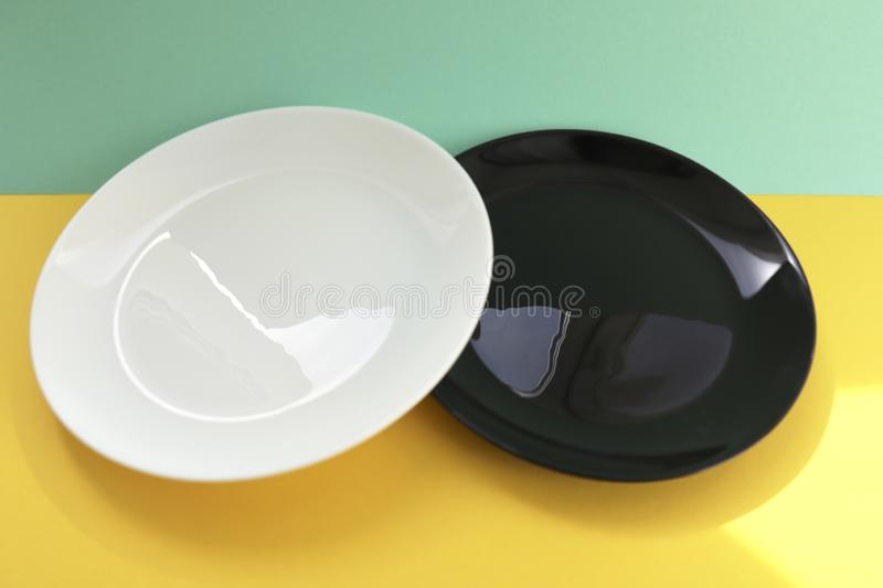 White and black empty plates royalty free stock image