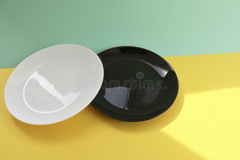 white and black empty plates royalty free stock photos
