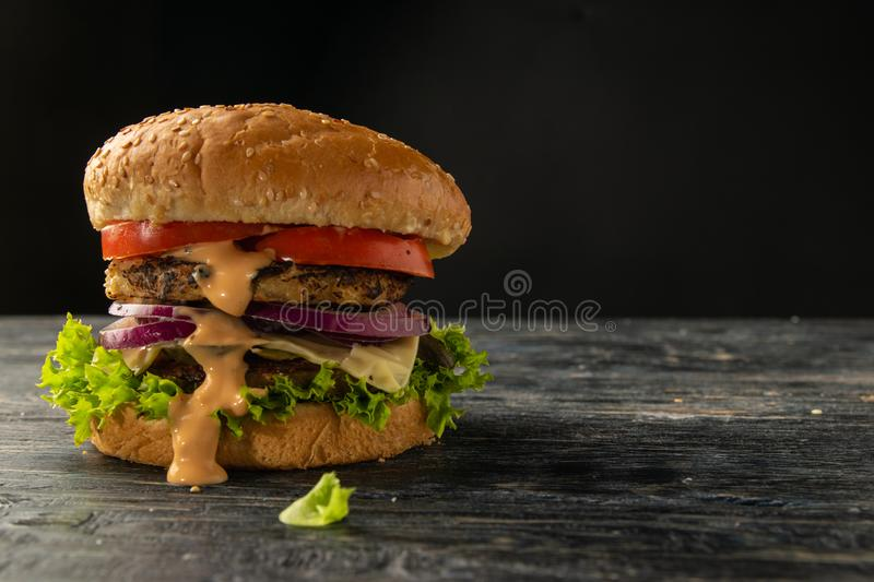 White and black hamburgers. Are served in different angles and with different fillings stock photo