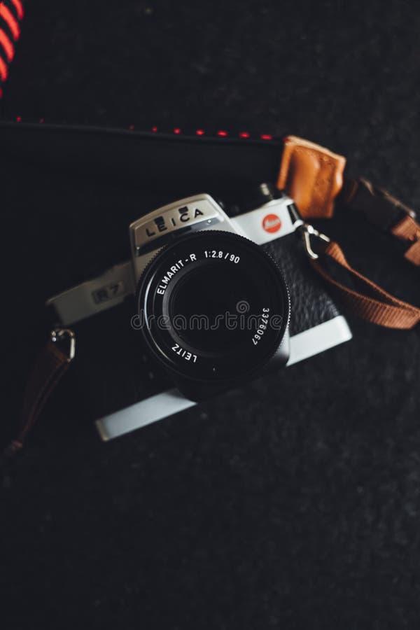 White and Black Leica Camera on Black Textile stock photo