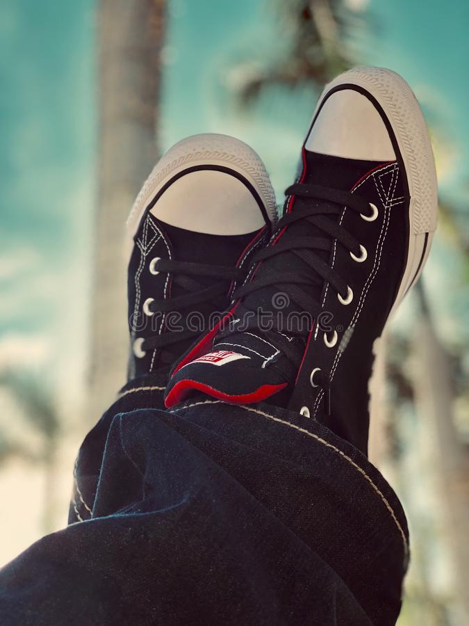 White-and-black Low-top Sneakers stock image