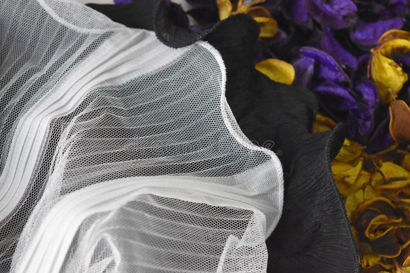 White and black mesh cloth has a soft ripple on the ground purple and yellow , For web design or graphic art image royalty free stock image