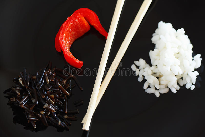 White and black rise and sweet pepper stock photography