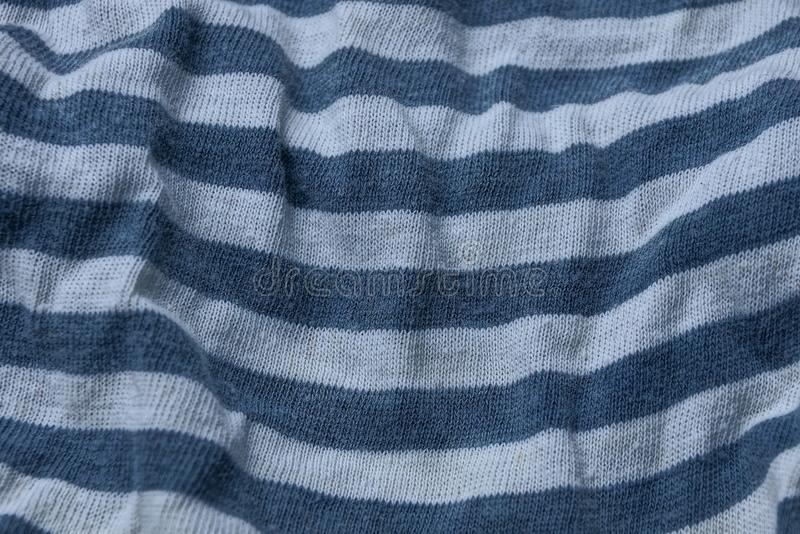 White black striped fabric background of crumpled old clothes. White black striped fabric texture from crumpled old clothes stock photography