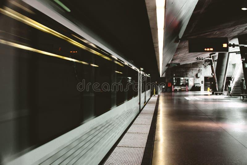White and Black Subway Train Inside Station stock image
