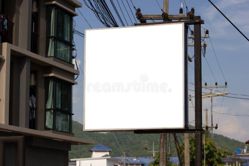 White blank billboard or signboard on street side for mock up . White blank billboard or signboard on street side for mock up presentation stock images