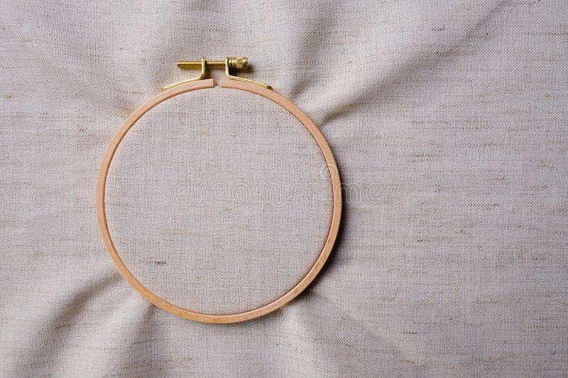White blank canvas on wooden round frame as a background. Flat lay top view stock photo