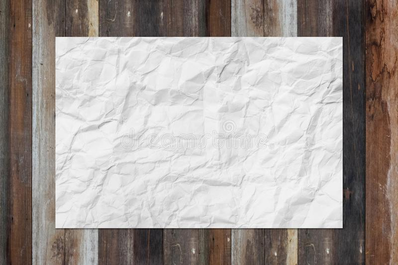 White blank crumpled paper on grunge wooden table royalty free stock image