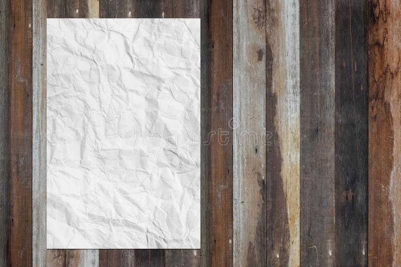 White blank crumpled paper on grunge wooden table royalty free stock photo