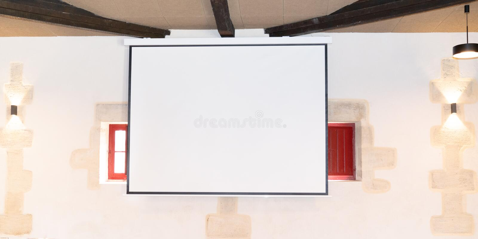 White blank empty screen for overhead projector in the meeting room stock photo