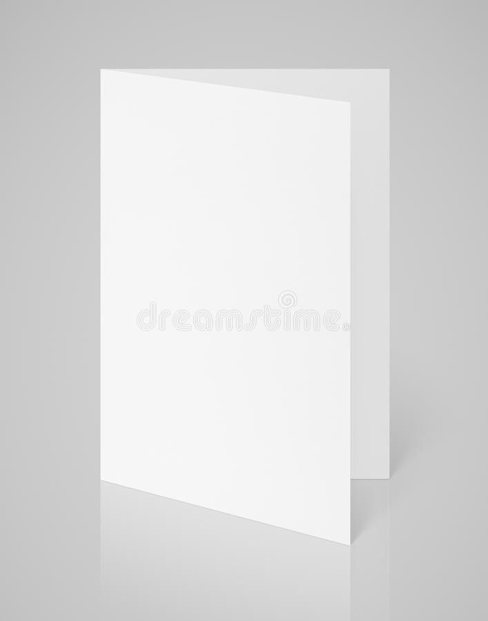 White blank folded flyer on gray royalty free stock photos