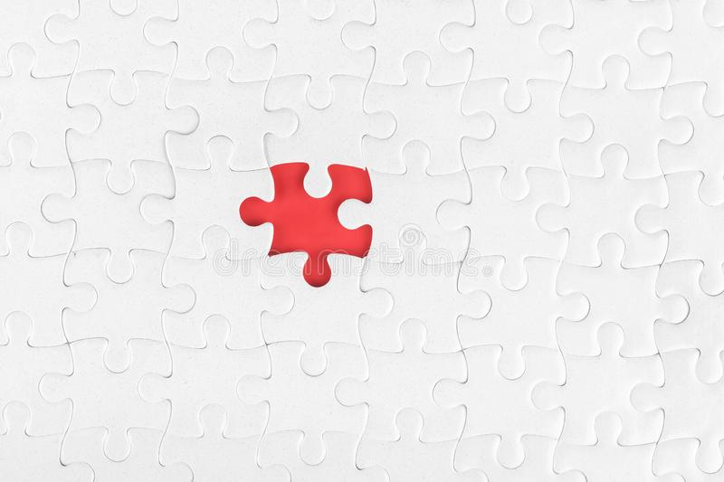 White blank jigsaw puzzle without one piece royalty free stock photography