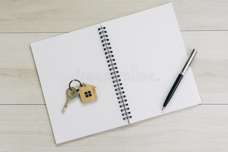 White blank page of notepad and pen on the right hand side, key stock photos