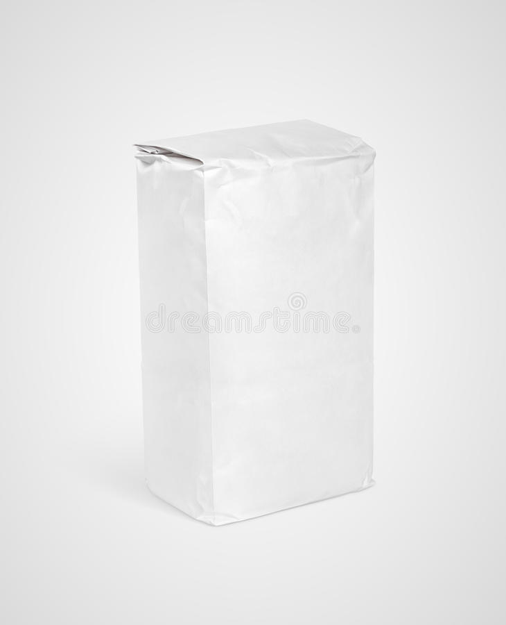 White blank paper bag package of flour on gray stock photos