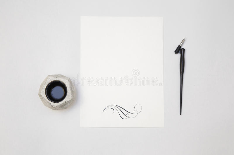 White blank paper sheet mockup with calligraphy nib and ink. White paper sheet mockup with calligraphy nib and ink. For invitation, wedding, decoration royalty free stock image