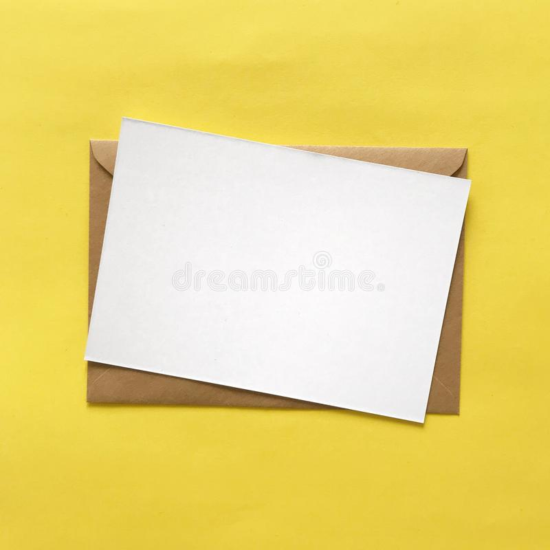 White Blank Postcard and Brown Envelope on Yellow stock images