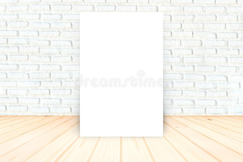 Blank Poster in White brick wall and wooden floor room,Tem royalty free stock image
