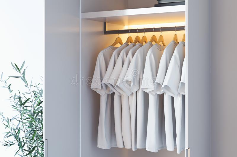 White blank t-shirt with copy space in modern cupboard. 3d rendering. White blank t-shirt with copy space in modern illuminated cupboard. 3d rendering stock illustration