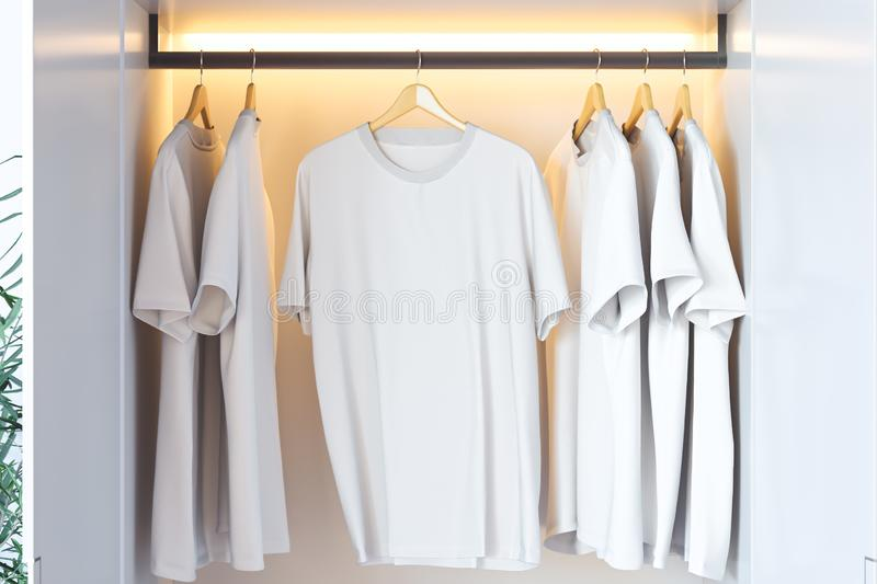 White blank t-shirt with copy space in modern cupboard. 3d rendering. White blank t-shirt with copy space in modern illuminated cupboard. 3d rendering royalty free illustration
