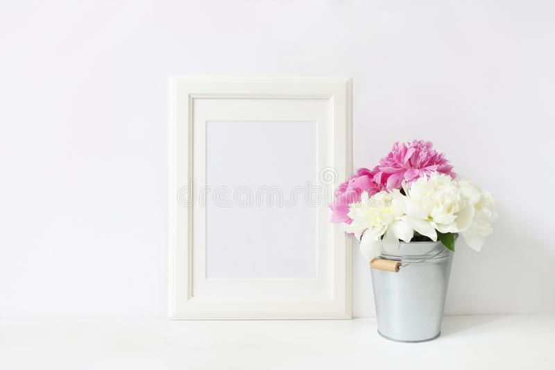 White blank wooden frame mockup. Wedding table still life composition with floral bouquet made of pink and white peony stock images