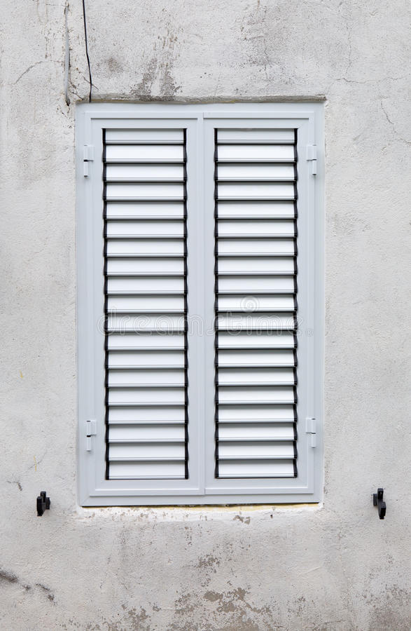 White blinded window. The white blinded window outside stock photography