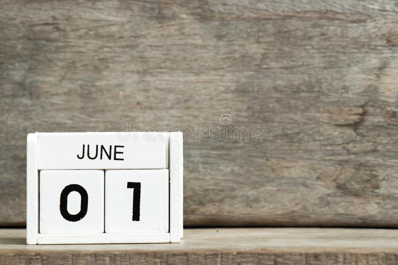 White block calendar present date 1 and month June on wood background. Icon, design, time, business, day, event, element, graphic, reminder, template, agenda royalty free stock photos