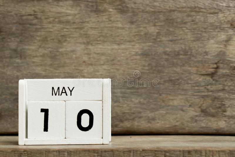 White block calendar present date 10 and month May on wood background stock images