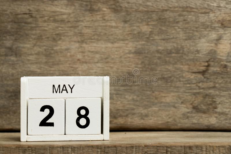 White block calendar present date 28 and month May on wood background. Design, graphic, business, day, year, element, event, time, reminder, number, holiday royalty free stock photos
