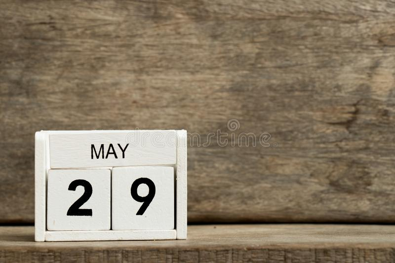 White block calendar present date 29 and month May on wood background. Design graphic business day year element event time reminder number holiday financial royalty free stock images