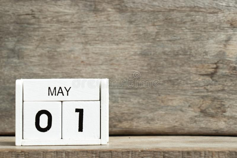 White block calendar present date 1 and month May on wood background. Icon design time business day event element graphic reminder template agenda year space royalty free stock photo
