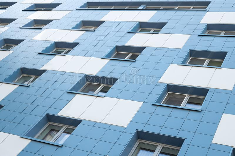 White and blue apartment building facade ground view. White and blue apartment building facade ground view royalty free stock photography