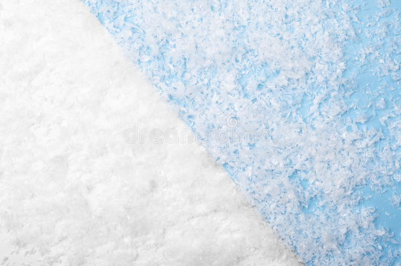 White and blue background with artificial snow. Winter texture royalty free stock photo