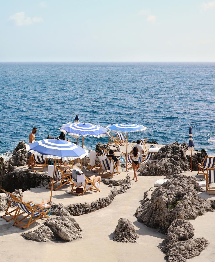 White and blue beach umbrellas in Capri stock image
