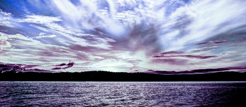 White and blue coloured cirrus cloud, coastal sunset seascape. royalty free stock photos