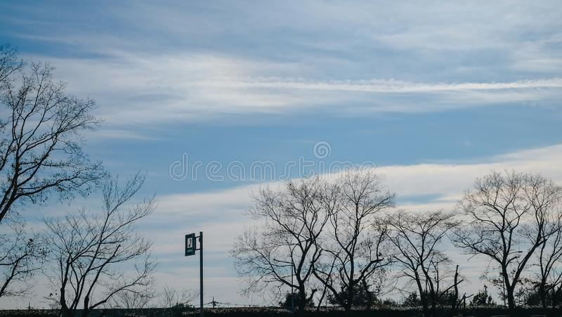 Sunny day with blue sky and white cloud. royalty free stock photography