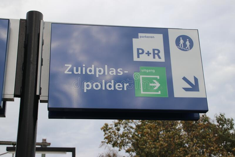 White and blue direction sign to Zuidplaspolder on the platform of train station Nieuwerkerk aan den IJssel royalty free stock photos