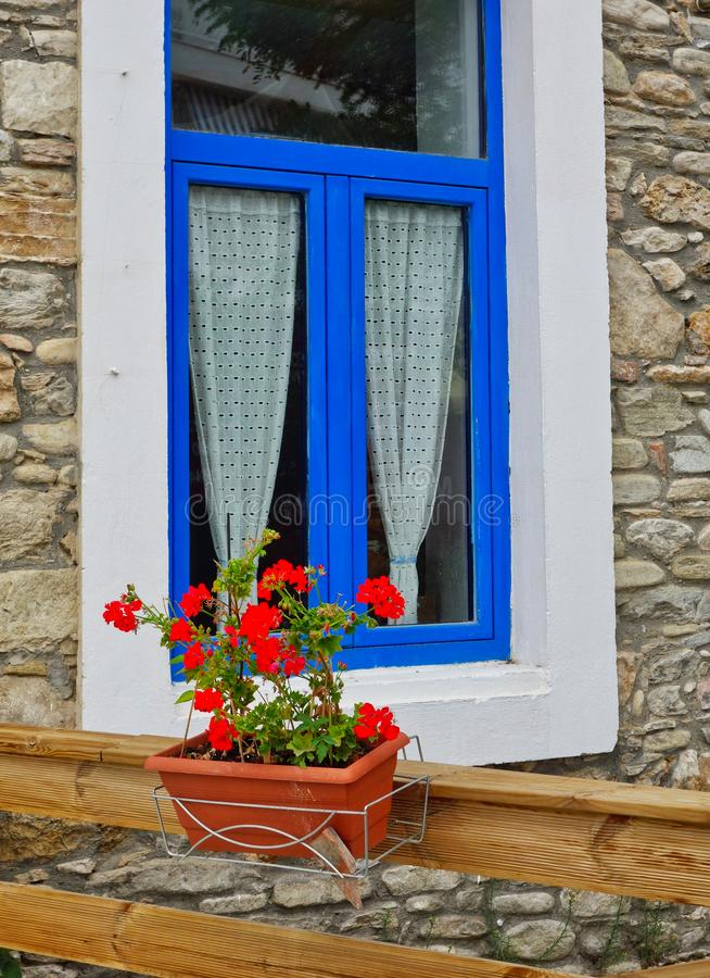 White and Blue Framed Window on Stone House, Greece royalty free stock photos