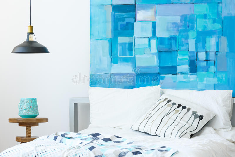 Interior with modern abstract painting. White and blue glamor bedroom interior with modern abstract painting stock photo