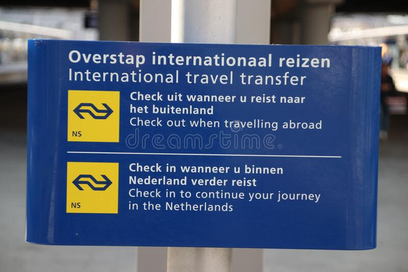 White and blue information sign at platform for transfer to internationa trains at Utrecht central station stock photo